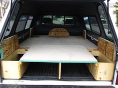 Details of a self-built camper, truck sleeping platform. Has a pull out table…