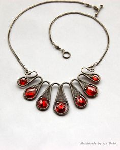 http://rubies.work/0274-ruby-rings/ Fire Orange Cubic Zirconia Necklace Wrapped in Silver Filled Wire, ooak. $67.00, via Etsy.