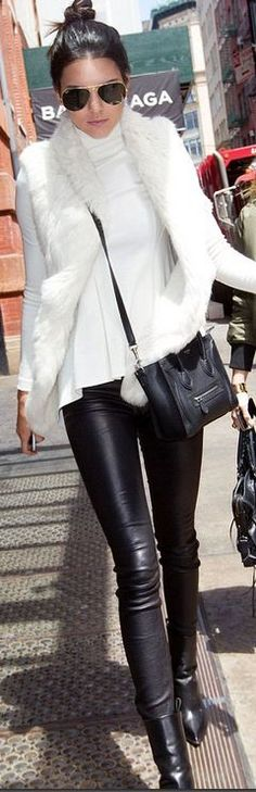 Who made Kendall Jenner's aviator sunglasses, leather handbag, white vest, and ankle boots?