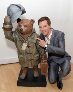 "Benedict Cumberbatch with the ""Sherlock"" Paddington Bear he designed as one of the British celebs participating in the Paddington Trail promotion (each designing their own bear) of 50 bears placed throughout London for the animated PADDINGTON movie starring Hugh Bonneville, which opens in the UK on November 28, 2014. His ""Sherlock"" bear is at The Museum of London, where a Sherlock Holmes exhibition had recently opened."