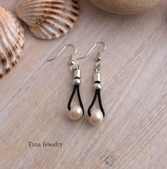 Dangle Earrings, River cultivated pearls, Pearls Silver Plated Earrings, Leather earrings Pearls Casual looking handmade earrings made in zamak, stainless steel and leather. Hooks made in stainless steel. ♥ In my store you can pay for the purchase in three ways ♥ -1. STANDARD SHIPPING