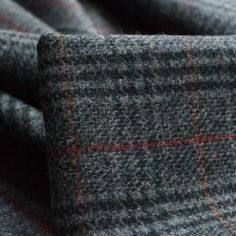 A stand out wool Yorkshire woven tweed jacketing in a mixture of grey and blue cloths in a sort of Prince of Wales check, with a fine line over check in red and orange, quite special. Tweed Fabric, Knitted Fabric, Kilt Accessories, Tartan Pattern, Fabric Shop, Wash Bags, Waterproof Fabric, Fabric Online, Sewing