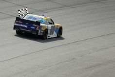 Dale Earnhardt Jr. Photos - Dale Earnhardt Jr., driver of the #88 Hellmann's Chevrolet, celebrates with the checkered flag after winning the NASCAR XFINITY Series ToyotaCare 250 at Richmond International Raceway on April 23, 2016 in Richmond, Virginia. - NASCAR XFINITY Series ToyotaCare 250