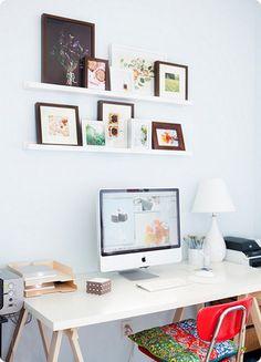 Small frames on shelves above desk - office inspiration