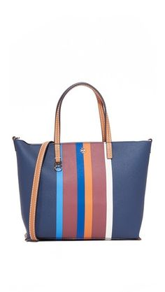 A scaled-down Tory Burch tote in striped faux leather. The inset top zip opens to a lined, 2-pocket interior. Double handles and optional, adjustable shoulder strap.