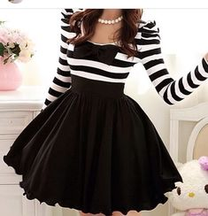 This is so Ariana grande / me I love this funky big  skirt with a dash of stripes on the top !! :)