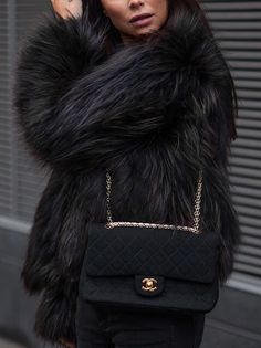 Black fur coat + a black Chanel purse.
