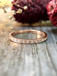 A beautiful diamond laced rose gold wedding band by StonesAndGold via etsy. #diamondring #rosegoldring #weddingrings