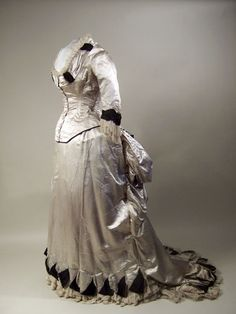 Half-mourning dress by W G Jay & Co, 1883-84 London, Manchester Art Gallery    Half-mourning dress (?) Pale grey satin trimmed with black figured and black corded silk and white net. Two piece.