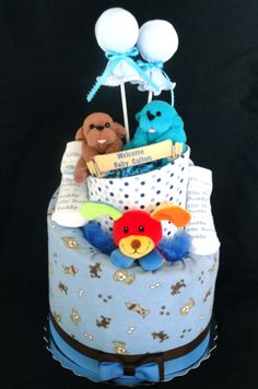 Puppy Themed 2 Tier Diaper Cake www.facebook.com/DiaperCakesbyDiana