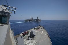 USS Carney (DDG 64) approaches the Military Sealift Command fleet replenishment oiler USNS Big Horn (T-AO-198) and USS Wasp (LHD 1) during a replenishment-at-sea in the Mediterranean Sea on Aug. 6, 2016. US Navy photo.