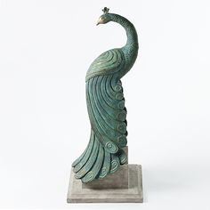 "Find it at <a href=""http://www.bombaycompany.com/"" target=""_blank"">bombaycompany.com</a>  - Royal Peacock Statuary"