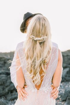 Minimalist wedding hairstyle from a romantic, destination sunset elopement wedding at Mosteiros Beach, San Miguel. #weddinghairstylesforlonghair #minimalistweddings #romanticweddings #beachweddinginspiration #destinationweddinginspiration