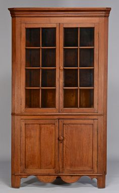 "East Tennessee Corner Cupboard. Walnut with Yellow Pine Secondary Wood and Glass. Sullivan or Washington Counties, Tennessee. Circa 1825. 81-3/4"" x 44-1/2"" x 23-3/4""."