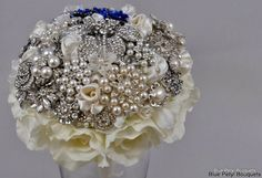 This custom bouquet combines two of our favorite bouquets! The Enchanted Rose and Lia Couture:) Can't wait to see it finished! #wedding #bouquet #bluepetyl