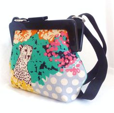Wild side..Cross body bag with adjustable strap. Chunky frame.