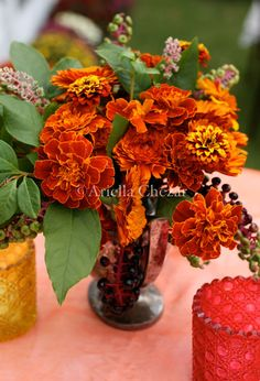 Marigolds, huh wouldn't have thought they'd make such a pretty arrangement & check out the site for their use in a garland