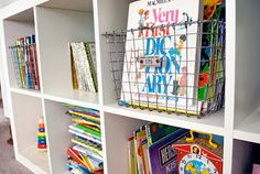 Wire baskets instead of fabric bins for children's books/toys.