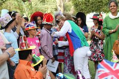Mad Hatter's Tea Party at the British Embassy in Bahrain British Traditions, Hm The Queen, British Royal Families, Queen Of England, Piece Of Cakes, British Royals, Kids Playing, Tea Party, Palace