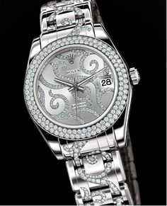 If anyone is asking, THIS is what I want for my birthday, or any day, for that matter!  SWEET ROLEX!!!