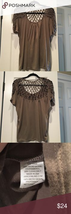 ☀️price drop Akiko top w braided shoulder AKIKO top in a mushroom taupe color. Batwing type sleeve w pleating in scoop neck center, criss cross knotted detail. Very unique. Slight spots in front of shirt as in photo 🔴, priced as such. Very good condition, slight signs of wear due to nature of soft fabric. Pet / smoke free home. Akiko Tops Blouses