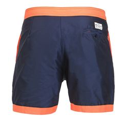 BOARDSHORTS COLOR BLUE/ORANGE Navy blue memory polyester mid-length Boardshorts with contrast fluorescent orange waistband and bottom. Fixed waistband with Velcro closure and adjustable drawstring. Two front pockets and welt back buttoned pocket. Cuisse de Grenouille brand patch on back. Internal net. COMPOSITION: 100% POLYESTER. Model wears size L, he is 189 cm tall and weighs 86 Kg.