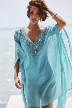 Add a hint of glamour to your poolside style with this embellished swim cover up. Luxe beaded detail immediately catches your eye, while the floaty caftan silhouette flatters like crazy.