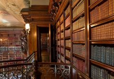 Have you ever wondered what's behind the doors on the top floor of the Library? Here's your peek. The doors located on both sides of the overmantel lead to a passageway connected to the Second Floor Living Hall.