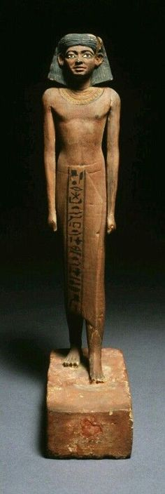 Statue of Tef-ib ca. 1980 BC (Middle Kingdom) MEDIUM carved wood with paint. BN