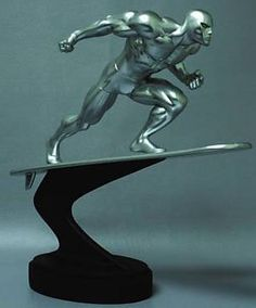 """Silver Surfer Action Statue by Bowen Designs! by Bowen Designs. $695.00. Leaning into the solar winds, the Silver Sufer rides the cosmic """"waves"""" as no other goofyfoot could ever imagine! Sculpted by Randy Bowen and standing 12"""" tall (with base), the noble and shiny Norrin Radd will be the centerpiece of any Marvel statue collection! Individually numbered with a full-color collector's box."""