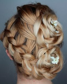 Looking for a braided style that's not too casual? This hairdo takes braids to whole other level. Webb used multiple braids to create a regal look that's perfect for a formal wedding.
