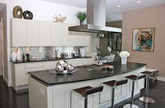 Another version of a multifunctional kitchen island, featuring sleek bar stools