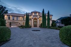 Tuscan style luxury home with porte-cochere entrance to Motor Court with garages