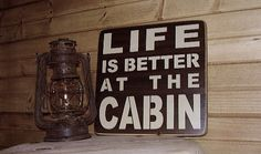 Etsy listing at http://www.etsy.com/listing/123076864/rustic-wooden-cabin-sign-life-is-better