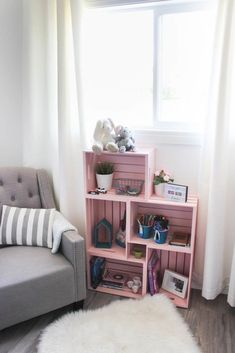 Use wooden crates and spray paint in a unique way to make some beautiful home decor for your child's bedroom or nursery! Love this pick colour for a girl's room! Pretty and pink :) diy bedroom decor DIY Crate Bookshelf Cool Bookshelves, Crate Bookshelf, Bookshelf Ideas, Girls Bookshelf, Book Shelves, Diy Bookshelf Design, Wood Crate Shelves, Bedroom Bookshelf, Small Bookshelf