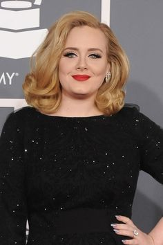 Adele... her hair was as winning as she was. Winning the most amount of Grammys last night it's probably a good thing her hair was so flawless. Her classic blonde curls made us reminiscent of an older time, which flows so well with her amazing voice. This was a winning hairstyle from a winning lady.