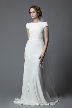 1920's vintage inspired style Tallulah in silk crepe bias cut full length gown with cut out back, cap sleeves and appliqué petals. Made in England designer vintage inspired wedding dresses simple wedding dresses.