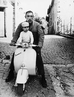 Anthony Quinn and son Lorenzo take a thoughtful pause on their Vespa in 1968.