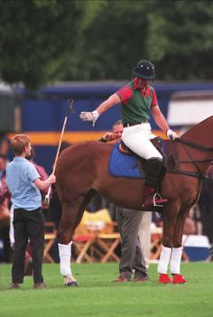July 04, 1998: Prince Harry handed his father Prince Charles a polo mallet during a polo match at Windsor.(x)