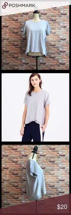 """J. Crew Silky Knit T-Shirt J. Crew Silky Knit T-Shirt in a size small.  Front bodice is a cotton knit, ad the sleeves, sides, and back are a silky fabric.  Pleating at the back of the neck.  Hi low hem.  Measures approximately 20"""" armpit to armpit, 21 1/2"""" in length in the front, and 25"""" in the back.  Front is 100% cotton, back and sleeves are 100% polyester.  In excellent condition. J. Crew Tops Tees - Short Sleeve"""