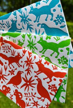 From our textiles series: the Otomi card. A hand drawn otomi design, letterpress printed in one of three colors: red, blue, or green. Specify