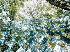 Chequered band of mirrors creates a psychedelic experience in a Budapest forest
