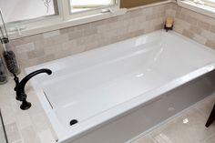 Innovative kohler archer in Bathroom Traditional with Deep Soaking Tub next to Bullnose Tile alongside Tiles Around Tub and Crema Marfil
