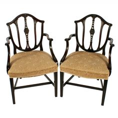 Pair of Hepplewhite Style Elbow Chairs   A pair of Edwardian mahogany elbow chairs in a Georgian Hepplewhite design.  The chairs have a domed top rail to the back which has a carved decoration to the pierced splats.  The chairs have short shepherd's crook arms that have a swept support, carved detail and a twin reeded edge.  The legs are square and tapering with a 'H' shaped cross stretcher.  The seats are 'stuff over' and upholstered in a contemporary pale gold coloured material.  These… Antique Chairs, Antique Furniture, Dining Bench, Dining Chairs, Armchair, Upholstery, Georgian, Carving, Victorian