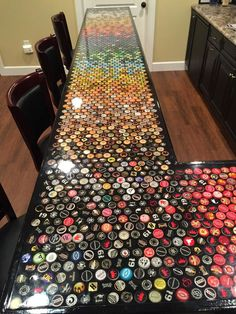 Five Years Worth of Bottle Cap Collection Turned into an Awesome Countertop! diy bar Build an awesome custom bottle cap bar top Custom Bottle Caps, Custom Bottles, Diy Bar, Beer Caps, Beer Cap Art, Bottle Cap Crafts, Bottle Labels, Beer Cap Crafts, Diy Bottle