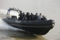 Members of the Metropolitan Thames River Police are pictured practicing boarding techniques in a Rigid Inflatable Boat (RIB) during an Olympic Games security exercise.  The Thames River Police lead maritime security exercise  in conjunction with the Royal Marines was carried out on the river Thames in preparation for the Olympic 2012  Games. Photographer: POA(Phot) Terry Seward Image 45153774.jpg from www.defenceimages.mod.uk  For latest news visit: www.mod.uk Follow us…