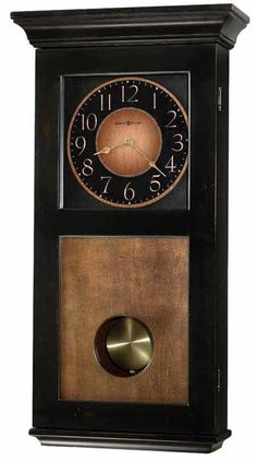 The stunning Howard Miller Corbin Wall Clock is finished in worn black with brown accents and features a vintage umber-finished lower door panel, dial,. Chiming Wall Clocks, Howard Miller Wall Clock, Analog Alarm Clock, Pendulum Wall Clock, Tabletop Clocks, Unique Clocks, Wall Ornaments, Wall Clock Design, Modern Clock
