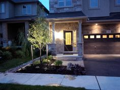 Front entry with night lighting.