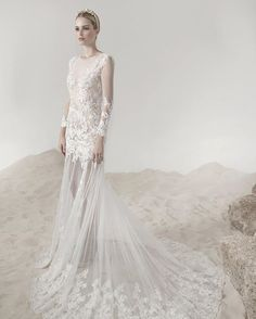Featuring sheer tulle and dainty lace, this #gown by Lee Grebenau is as fitting for a beach-side luxury wedding as it is for a reception in a grand hall. | WedLuxe Magazine | #luxury #wedding #weddinginspiration #weddinggown #dress #fashion