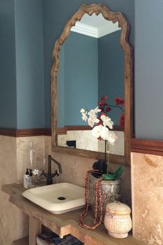 large scale mirror adds impact to a small guest bathroom